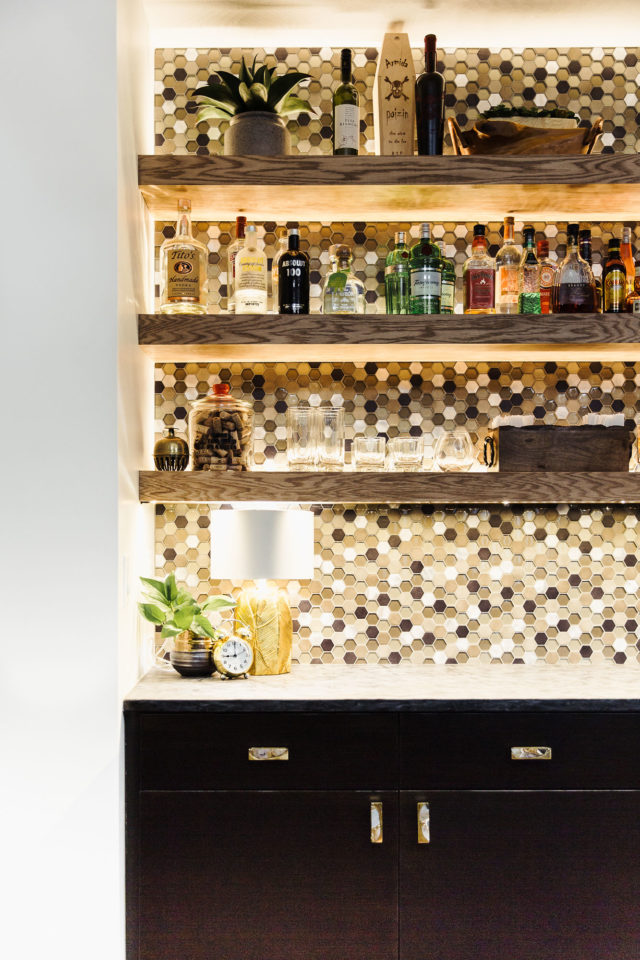 bar with glass tile backsplash