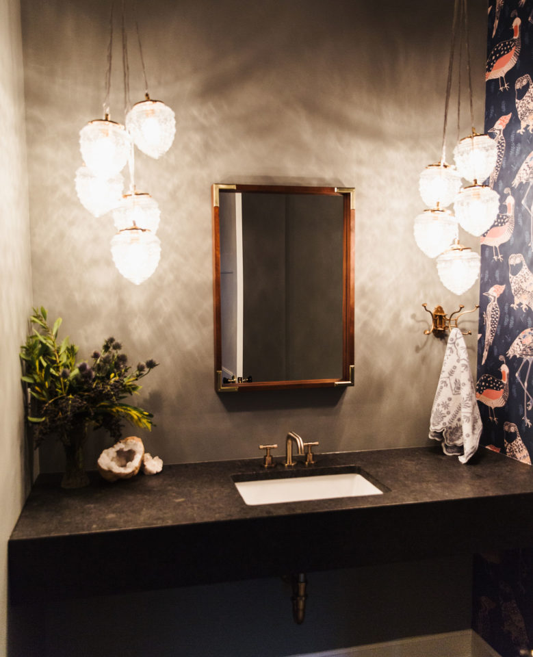 bathroom with stone countertops