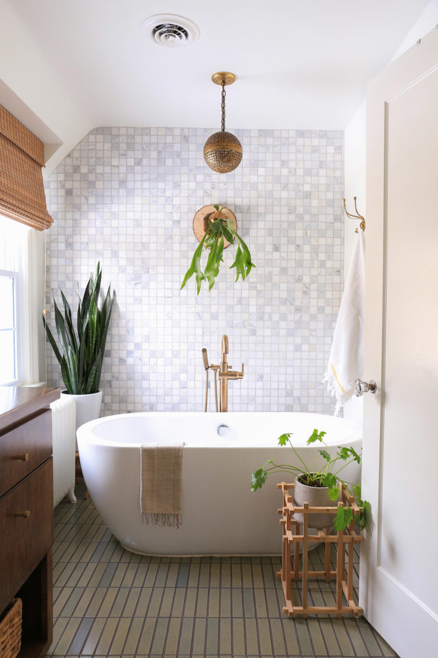 bathroom with tile wall
