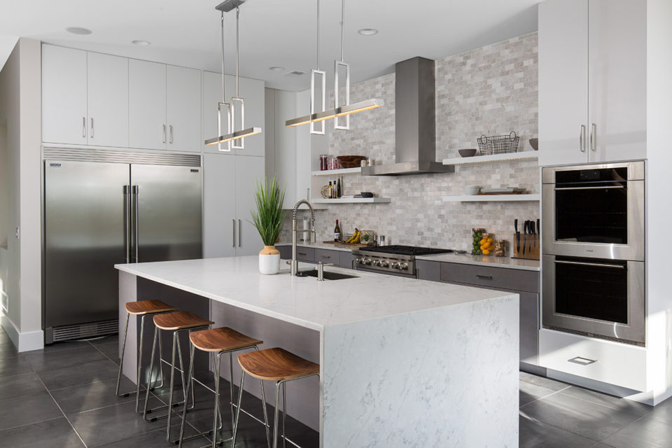 kitchen with large white quartz island with a waterfall edge