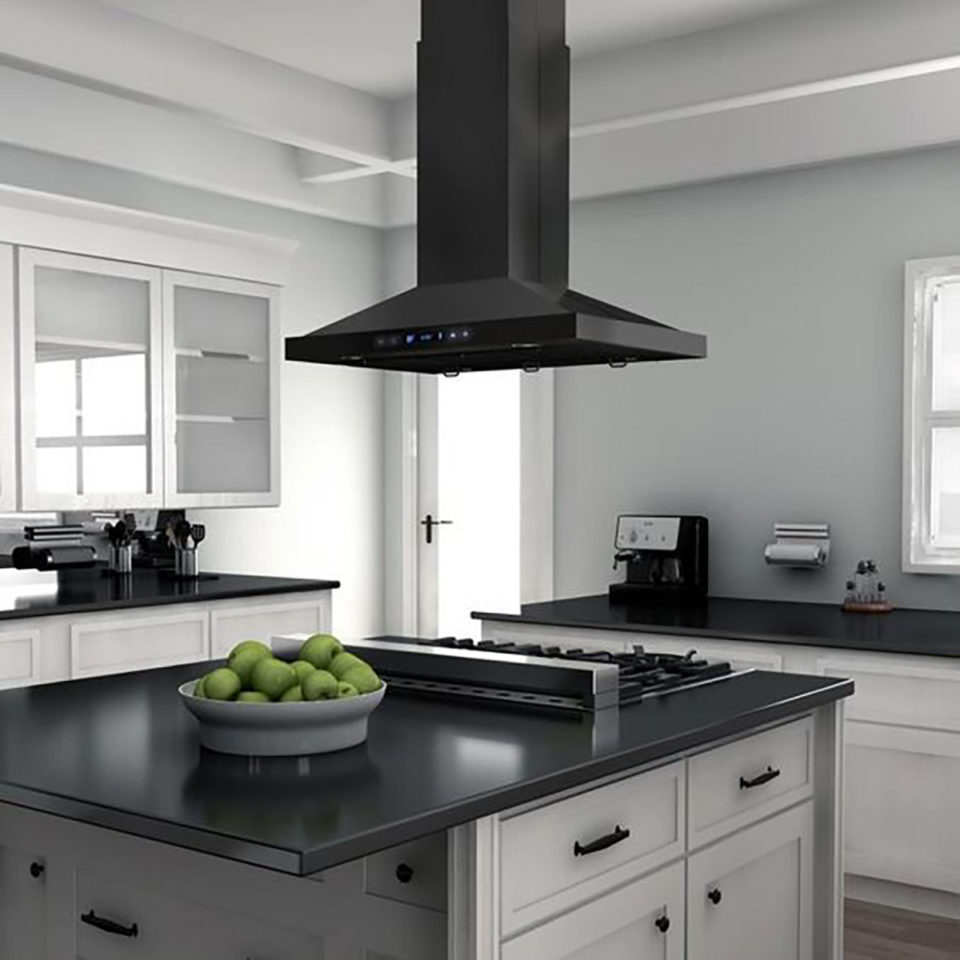 kitchen island with a gas cooktop and hood