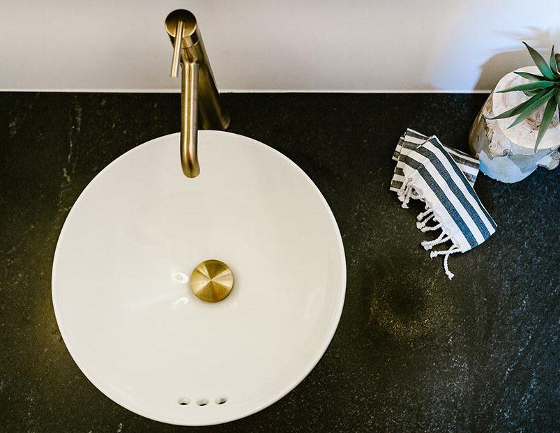 granite bathroom vanity with white vessel sink