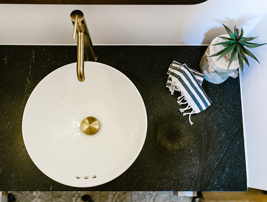 granite bathroom vanity with white vessel sink