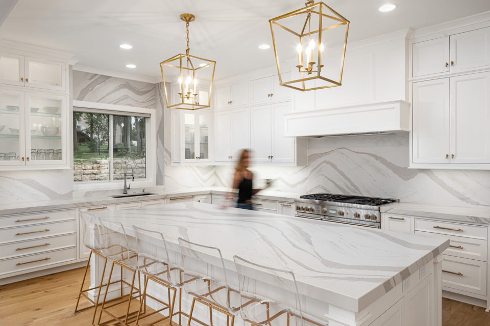 Large island and kitchen surround with quartz countertop