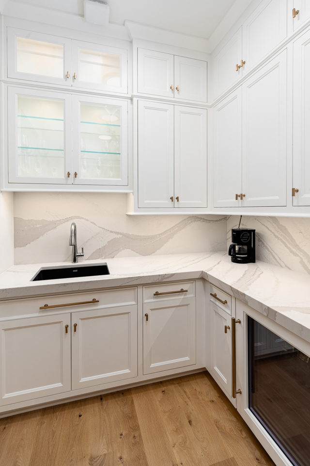 Pantry with quartz countertop and quartz backsplash