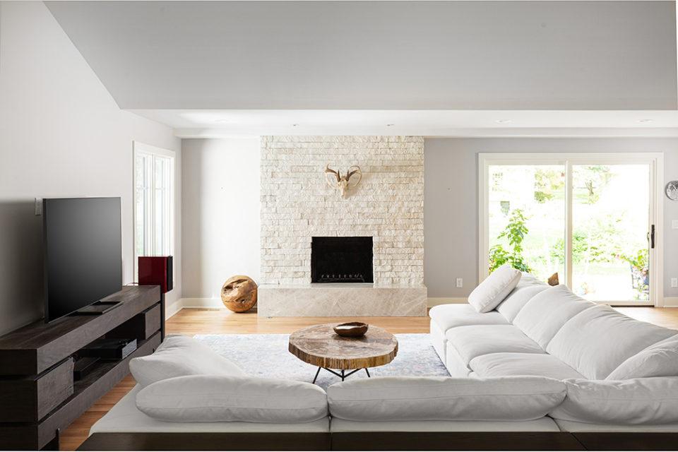 large stone fireplace, taj mahal quartzite with a mitered edge, homes that rock