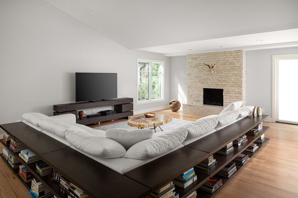 homes that rock, living room with stone fireplace, mitered edge, taj mahal