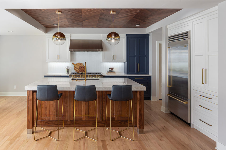 kitchen island with cabinetry with a mitered edge, homes that rock