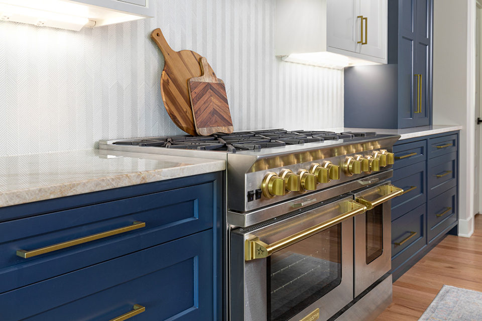 up close surrounding countertop with blue cabinetry, homes