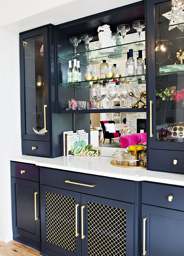 wet bar with navy cabinets
